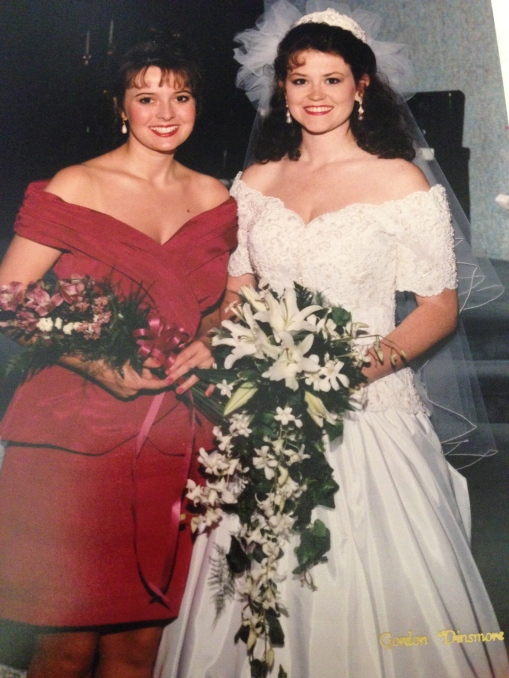 With my maid of honor, Tina Moore McGarry. Updos, fresh flowers and another great memory together.