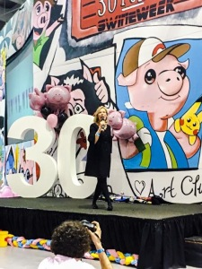 Barbara speaking at a Swine Week assembly.